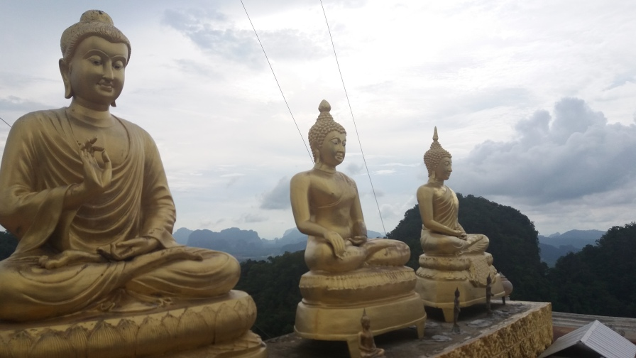 Three Buddhas at the top of the mountain